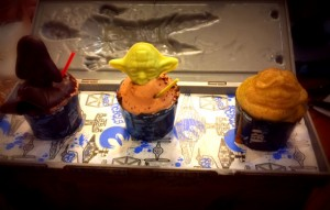 Trio of Star Wars mini cupcakes, including Mini Darth Vader (chocolate-peanut butter), Mini Yoda (chocolate-hazelnut), and Mini Jabba the Hutt (salted caramel latte) served in the Han Solo Carbonite Souvenir Box (16.99)