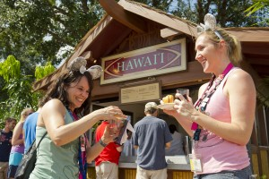 Foodies can sample the popular Kalua Pork Slider and refreshing beverages from Hawaii and other international marketplaces at the Epcot International Food & Wine Festival. (Matt Stroshane, photographer)