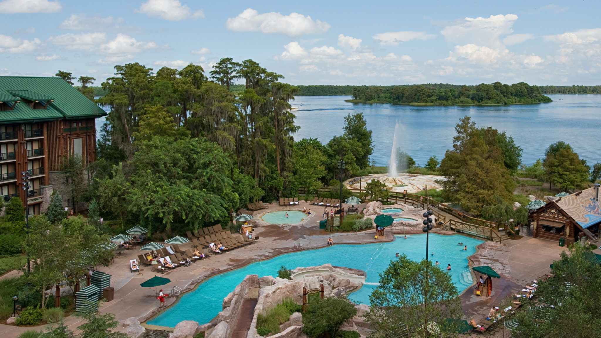 Inspired by turn-of-the-century national park lodges, Disney's Wilderness Lodge combines rustic charm with a contemporary flair on the shore of Bay Lake at Walt Disney World Resort. The 727-room hideaway features a spectacular six-story lobby, replete with teepee-topped chandeliers, totem poles, an 82-foot-tall stone fireplace and a bubbling hot spring that expands outside the building into a roaring waterfall. Walt Disney World Resort is located in Lake Buena Vista, Fla. (Disney)