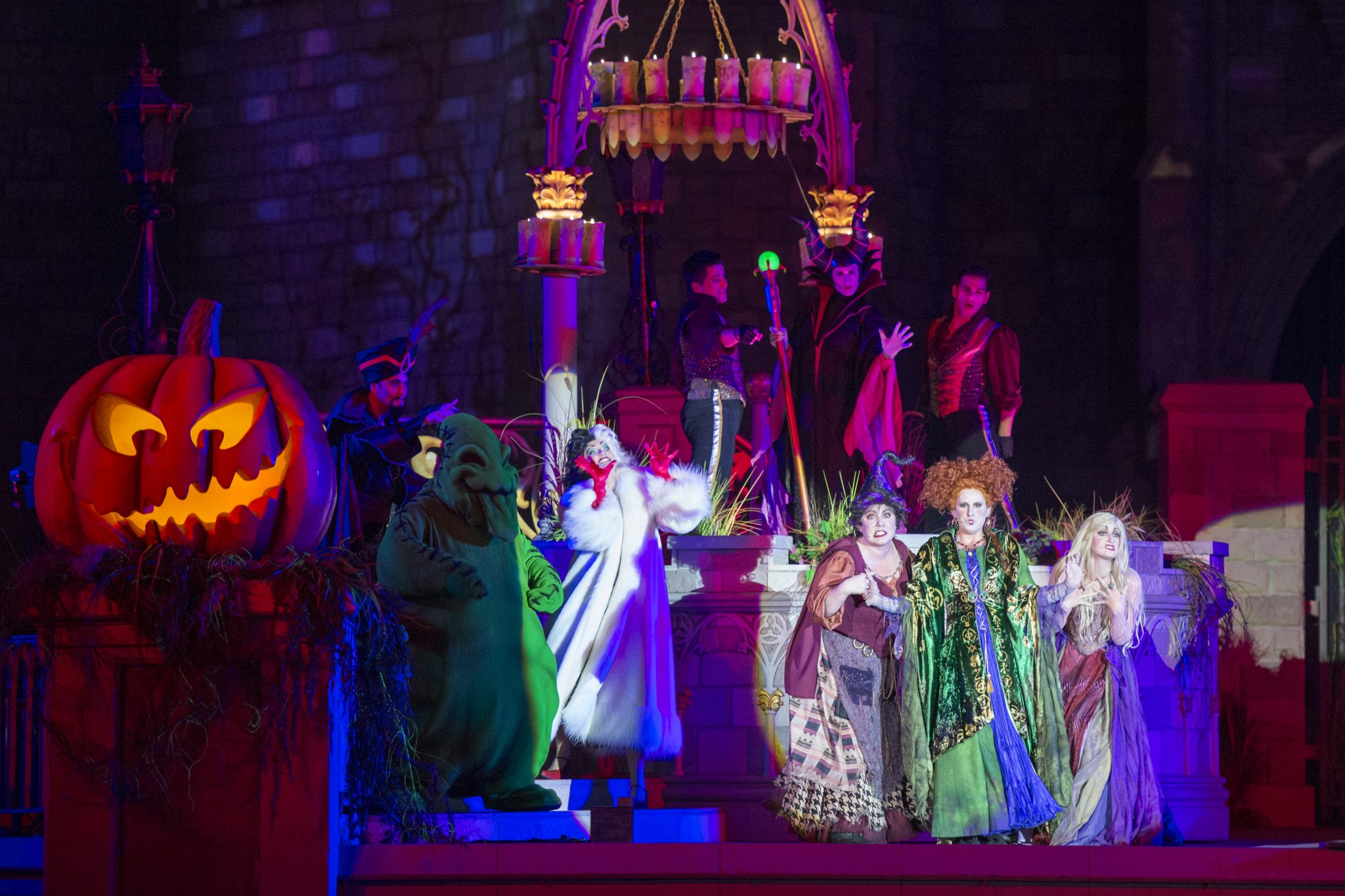 "New in 2015, the ""Hocus Pocus Villain Spelltacular,"" show during Mickey's Not-So-Scary Halloween Party at Magic Kingdom Park features the mischievous Sanderson Sisters from Disney's Hocus Pocus, who throw an evil Halloween party with appearances by Dr. Facilier, Oogie Boogie, Maleficent and other Disney villains, along with dancers, projections and special effects. Walt Disney World Resort is located in Lake Buena Vista, Fla. (David Roark, photographer)"