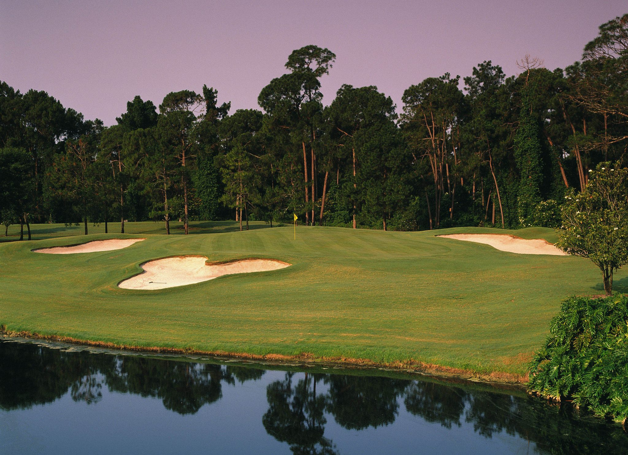 MOUSE TRAP ÐThe signature hole among the 99 holes of Walt Disney World golf is the Magnolia No. 6 a par 3 on which a bunker in the form of none other fronts the green than you know who.